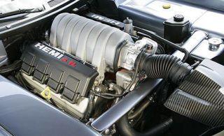 Photograph, Machine, Engine, Black, Automotive radiator part, Automotive engine part, Metal, Cylinder, Silver, Steel,
