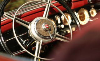 Motor vehicle, Mode of transport, Steering wheel, Steering part, Spoke, Classic car, Metal, Close-up, Classic, Circle,