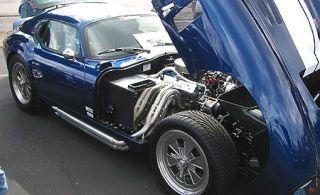Motor vehicle, Tire, Automotive design, Blue, Mode of transport, Vehicle, Transport, Car, Photograph, Rim,