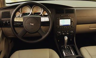 Motor vehicle, Mode of transport, Steering part, Brown, Steering wheel, Transport, Car, Photograph, White, Center console,