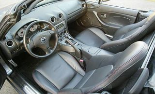Motor vehicle, Steering part, Mode of transport, Steering wheel, Center console, Photograph, Car seat, White, Personal luxury car, Vehicle door,
