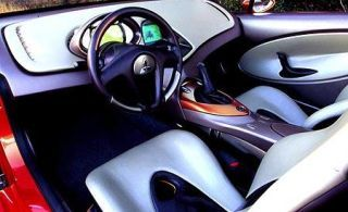 Motor vehicle, Mode of transport, Automotive design, Blue, White, Steering wheel, Steering part, Carmine, Black, Teal,