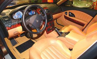 Motor vehicle, Steering part, Mode of transport, Steering wheel, Vehicle, Center console, Car, Car seat, Personal luxury car, Luxury vehicle,