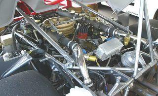 Motor vehicle, Engine, Automotive engine part, Metal, Auto part, Machine, Pipe, Automotive air manifold, Automotive fuel system, Nut,