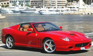 Tire, Wheel, Mode of transport, Automotive design, Vehicle, Transport, Hood, Red, Rim, Automotive parking light,
