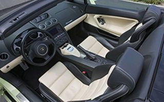 Motor vehicle, Mode of transport, Steering part, Steering wheel, Photograph, White, Center console, Luxury vehicle, Personal luxury car, Car seat,