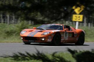 Tire, Vehicle, Automotive design, Motorsport, Sports car racing, Headlamp, Performance car, Road, Road surface, Car,
