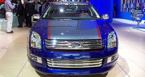 Motor vehicle, Automotive design, Blue, Vehicle, Land vehicle, Car, Grille, Headlamp, Automotive lighting, Bumper,