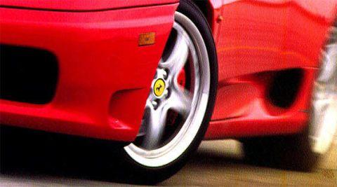Automotive exterior, Red, Rim, Alloy wheel, Carmine, Automotive wheel system, Auto part, Supercar, Bumper, Synthetic rubber,