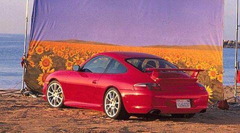 Tire, Wheel, Vehicle, Automotive design, Car, Rim, Landscape, Alloy wheel, Red, Fender,