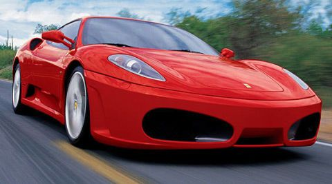 Tire, Wheel, Mode of transport, Automotive design, Vehicle, Transport, Red, Car, Rim, Performance car,
