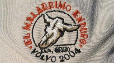 Textile, Symbol, Logo, Embroidery, Emblem, Trademark, Needlework, Creative arts, Stitch, Badge,