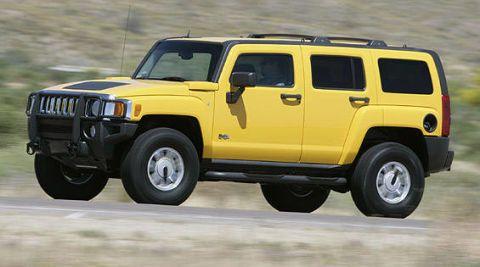 Tire, Wheel, Motor vehicle, Automotive tire, Mode of transport, Automotive design, Automotive exterior, Vehicle, Yellow, Natural environment,