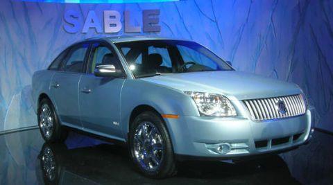 Tire, Motor vehicle, Wheel, Automotive mirror, Mode of transport, Blue, Automotive tire, Automotive design, Vehicle, Product,