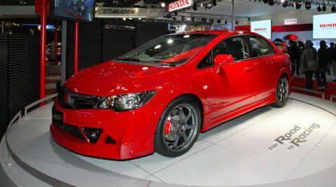Automotive design, Mode of transport, Vehicle, Land vehicle, Event, Car, Auto show, Exhibition, Automotive lighting, Logo,