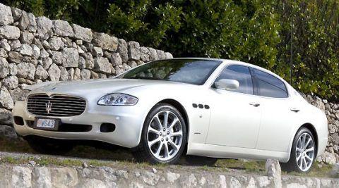 Tire, Vehicle, Rim, Alloy wheel, Car, Grille, White, Spoke, Personal luxury car, Luxury vehicle,
