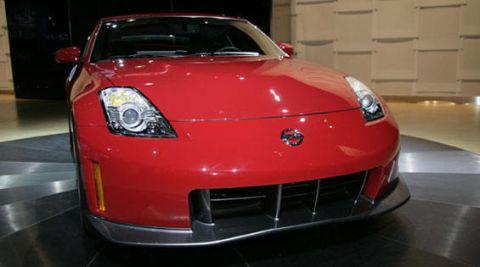 Automotive design, Vehicle, Hood, Land vehicle, Car, Transport, Automotive lighting, Grille, Red, Automotive exterior,