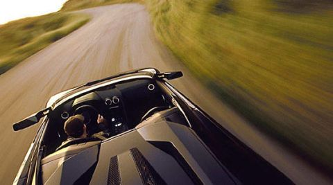 Automotive design, Road, Automotive exterior, Car, Hood, Glass, Windscreen wiper, Plain, Windshield, Supercar,