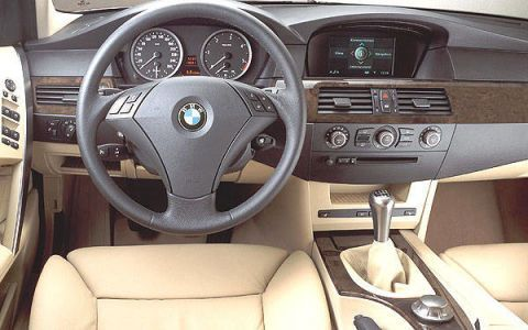 Motor vehicle, Steering part, Mode of transport, Steering wheel, Product, Brown, Automotive mirror, Center console, White, Car seat,