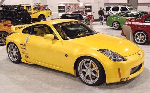 Tire, Wheel, Motor vehicle, Automotive design, Vehicle, Yellow, Land vehicle, Automotive tire, Rim, Alloy wheel,