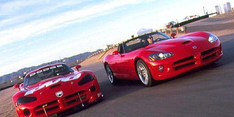 Automotive design, Vehicle, Hood, Land vehicle, Performance car, Car, Red, Sports car racing, Automotive lighting, Sports car,