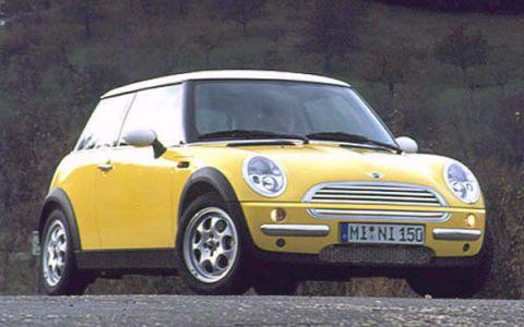 Automotive design, Vehicle, Yellow, Land vehicle, Infrastructure, Vehicle door, Hood, Photograph, Car, Grille,