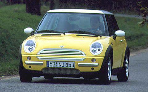 Motor vehicle, Automotive design, Vehicle, Yellow, Land vehicle, Grille, Vehicle registration plate, Car, Automotive mirror, Vehicle door,
