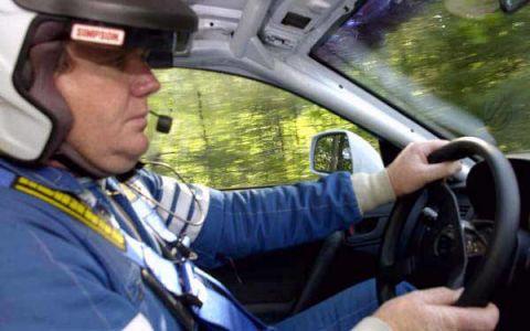 Motor vehicle, Mode of transport, Automotive design, Steering part, Helmet, Steering wheel, Automotive mirror, Glass, Windshield, Personal protective equipment,