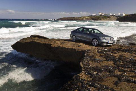 Land vehicle, Water, Car, Ocean, Wave, Automotive parking light, Luxury vehicle, Sea, Wind, Mid-size car,