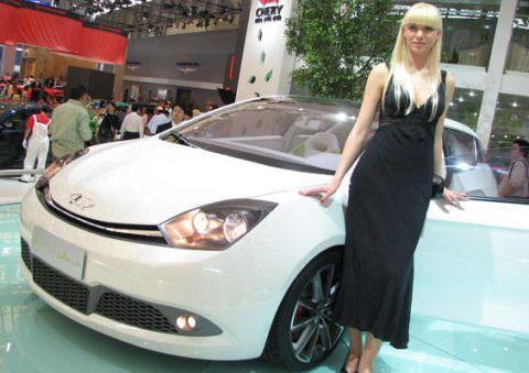 Automotive design, Vehicle, Event, Land vehicle, Headlamp, Automotive lighting, Car, Auto show, Exhibition, Dress,