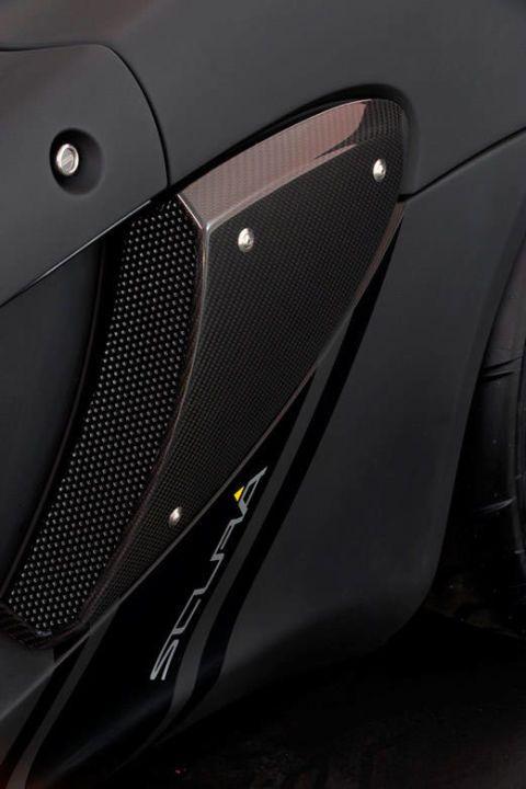 Automotive design, Automotive exterior, Fender, Carbon, Black, Grey, Loudspeaker, Vehicle door, Grille, Supercar,