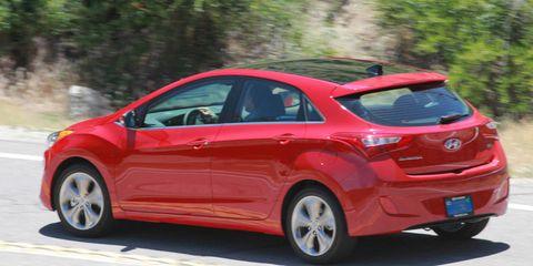 Motor vehicle, Wheel, Tire, Mode of transport, Automotive design, Vehicle, Car, Red, Automotive mirror, Hatchback,