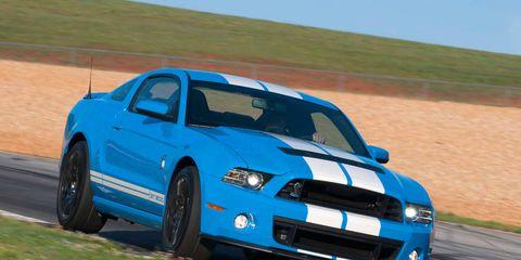 Automotive design, Blue, Daytime, Hood, Headlamp, Grille, Plain, Landscape, Car, Automotive exterior,