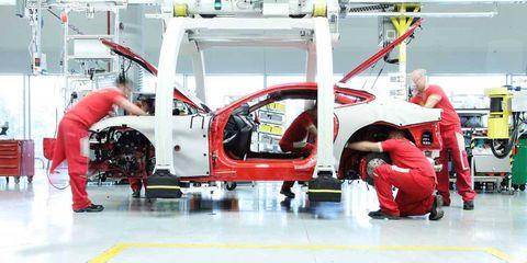 Automotive design, Floor, Engineering, Machine, Service, Automobile repair shop, Industry, Mechanic, Auto part, Factory,
