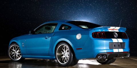 Tire, Wheel, Motor vehicle, Automotive design, Blue, Automotive tire, Vehicle, Automotive lighting, Automotive wheel system, Rim,