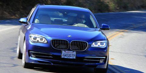Automotive design, Blue, Vehicle, Hood, Automotive exterior, Land vehicle, Grille, Car, Automotive lighting, Bumper,