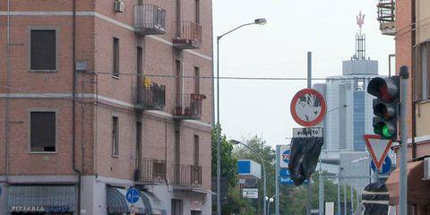 Neighbourhood, Town, Building, Facade, Urban area, Street light, Metropolitan area, Pole, Signage, Sign,