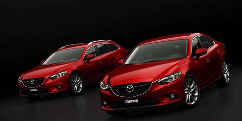 Mode of transport, Automotive design, Vehicle, Land vehicle, Car, Red, Automotive lighting, Personal luxury car, Mid-size car, Luxury vehicle,