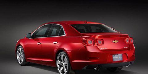 Motor vehicle, Tire, Wheel, Automotive design, Automotive tail & brake light, Product, Vehicle, Car, Automotive lighting, Red,