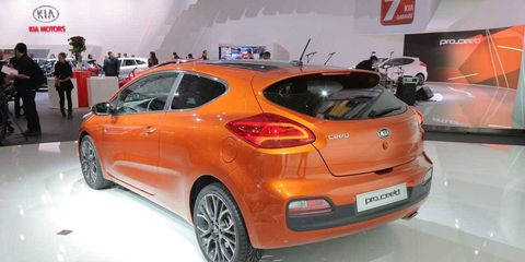 Tire, Motor vehicle, Wheel, Automotive design, Mode of transport, Vehicle, Land vehicle, Car, Vehicle registration plate, Auto show,