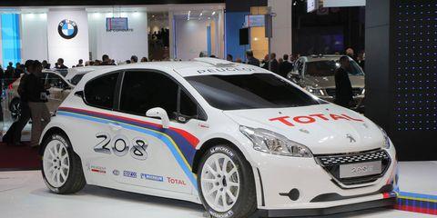 Motor vehicle, Wheel, Tire, Automotive design, Mode of transport, Vehicle, Land vehicle, Event, Car, Automotive tire,