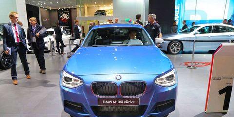 Automotive design, Vehicle, Land vehicle, Event, Car, Grille, Personal luxury car, Luxury vehicle, Auto show, Exhibition,