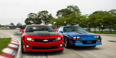 Tire, Automotive design, Vehicle, Land vehicle, Hood, Road, Infrastructure, Car, Grille, Automotive mirror,
