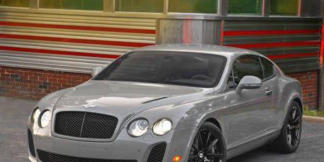 Grille, Bentley, Rim, Fender, Hood, Automotive lighting, Alloy wheel, Luxury vehicle, Black, Grey,