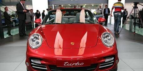Motor vehicle, Automotive design, Mode of transport, Vehicle, Car, Red, Automotive exterior, Bumper, Sports car, Automotive lighting,