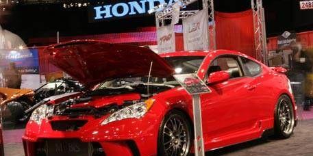 Tire, Wheel, Automotive design, Mode of transport, Vehicle, Land vehicle, Performance car, Car, Red, Rim,