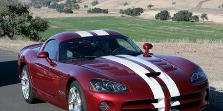 Tire, Mode of transport, Automotive design, Vehicle, Land vehicle, Hood, Headlamp, Automotive mirror, Automotive lighting, Red,