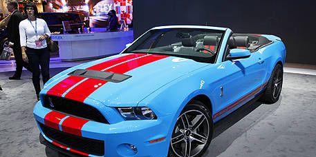 Automotive design, Blue, Vehicle, Hood, Headlamp, Automotive lighting, Car, Grille, Performance car, Fender,