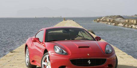 Motor vehicle, Automotive design, Mode of transport, Coastal and oceanic landforms, Vehicle, Car, Performance car, Red, Rim, Hood,