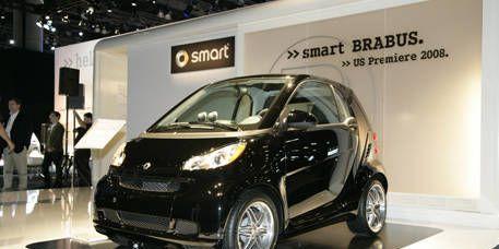 Tire, Motor vehicle, Wheel, Automotive design, Vehicle, Car, Alloy wheel, Vehicle door, Auto show, Automotive mirror,